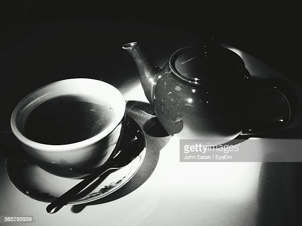 High Angle View Of Tea With Kettle On Table