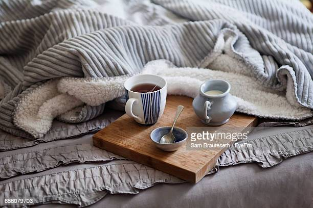 High Angle View Of Tea With Milk Served On Bed At Home