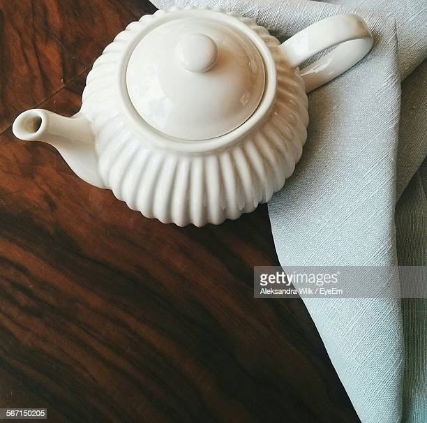 high angle view of teapot on wooden table - ティーポット ストックフォトと画像