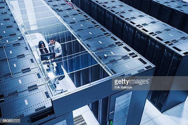 High angle view of technicians working in server room