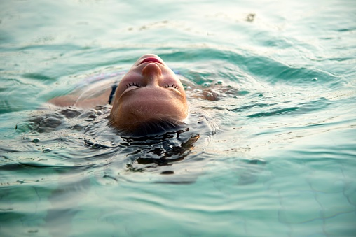 High Angle View Of Teenage Girl Swimming In Pool - gettyimageskorea