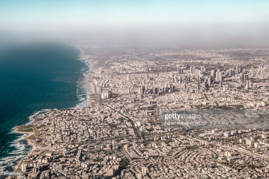 High Angle View Of Tel Aviv Cityscape By Sea Against Sky : Stock Photo