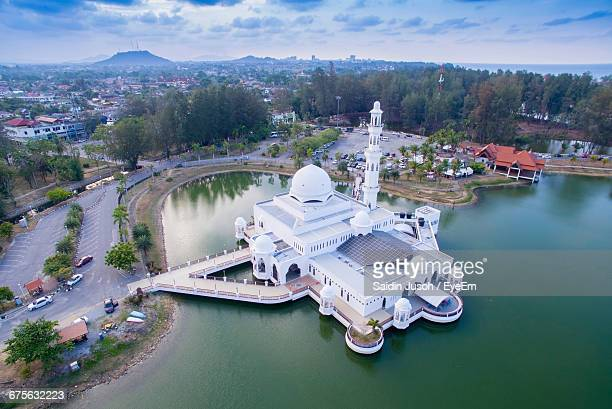 high angle view of tengku tengah zaharah mosque in lake against sky - terengganu stock pictures, royalty-free photos & images