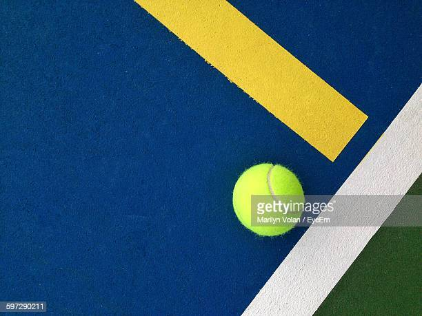 high angle view of tennis ball on court - tennis ball stock pictures, royalty-free photos & images