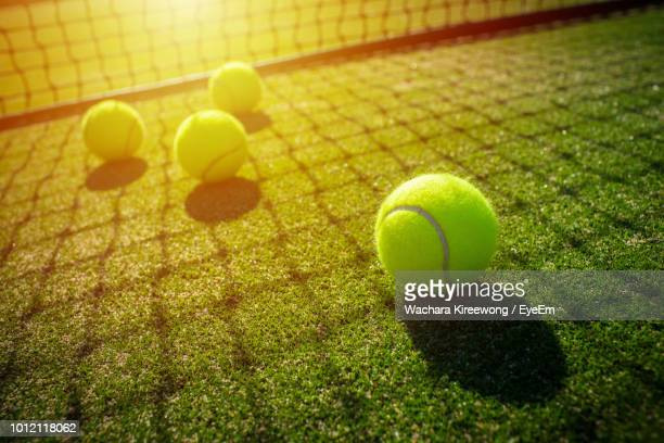 high angle view of tennis balls on field in court - tennis stock pictures, royalty-free photos & images