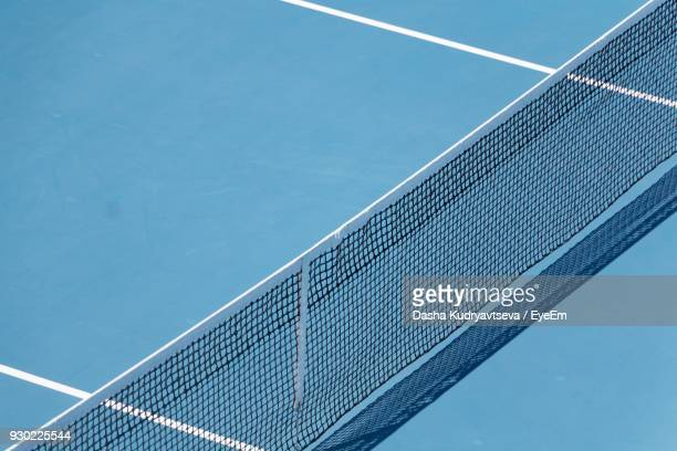 high angle view of tennis net at court - tennis stock pictures, royalty-free photos & images