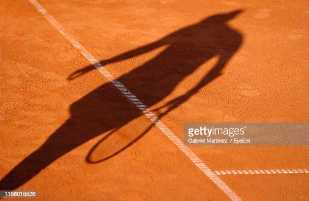 high angle view of tennis player on court - tennis player stock pictures, royalty-free photos & images