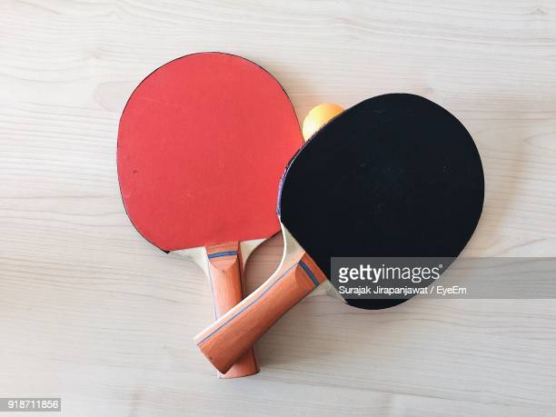 High Angle View Of Tennis Rackets And Ball On Table