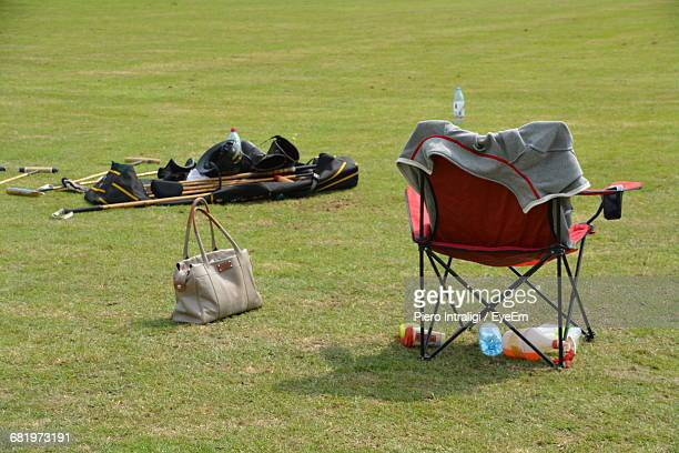 high angle view of tent with purse and folding chair on field at campsite - cadeira dobrável - fotografias e filmes do acervo