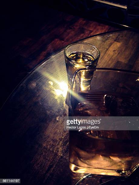 High Angle View Of Tequila And Whiskey On Table