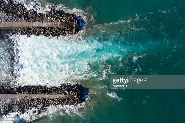 High Angle View Of Tetrapods By Sea