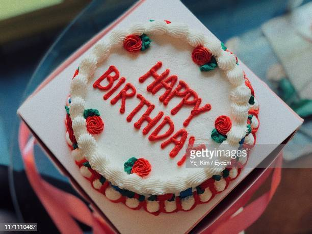 high angle view of text on birthday cake at home - birthday cake stock pictures, royalty-free photos & images