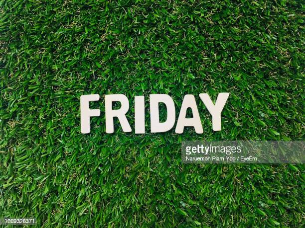 high angle view of text on grass, friday - friday stock pictures, royalty-free photos & images