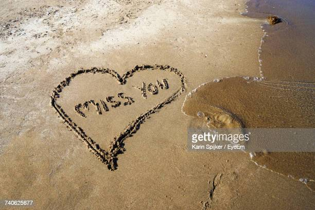 High Angle View Of Text On Heart Shape On Sand