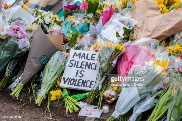 high angle view of text on paper at market stall - memorial vigil stock pictures, royalty-free photos & images