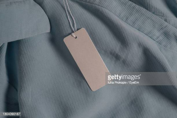 high angle view of text on paper - clothing stock pictures, royalty-free photos & images
