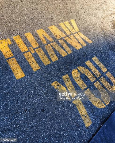 high angle view of text on street - henry street stock pictures, royalty-free photos & images