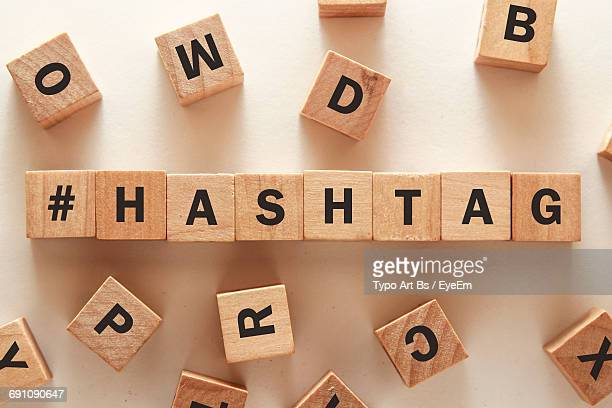 High Angle View Of Text On Wooden Blocks Over Table