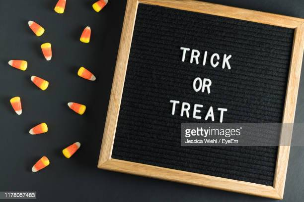 high angle view of text over board on table - candy corn stock photos and pictures