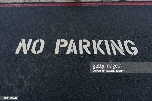high angle view of text written on road - oleksandr vakulin stock pictures, royalty-free photos & images