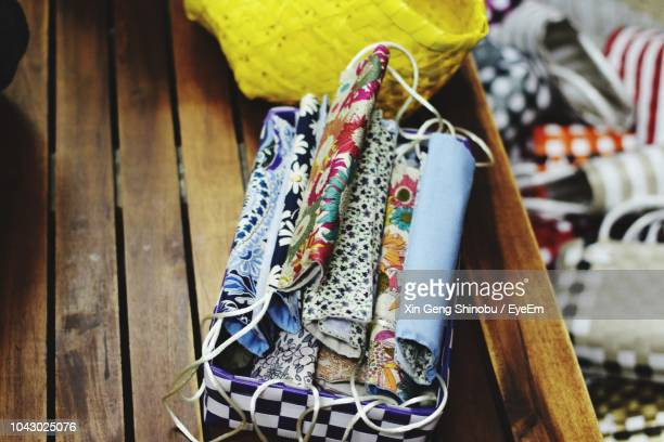 High Angle View Of Textile In Bag On Wooden Table