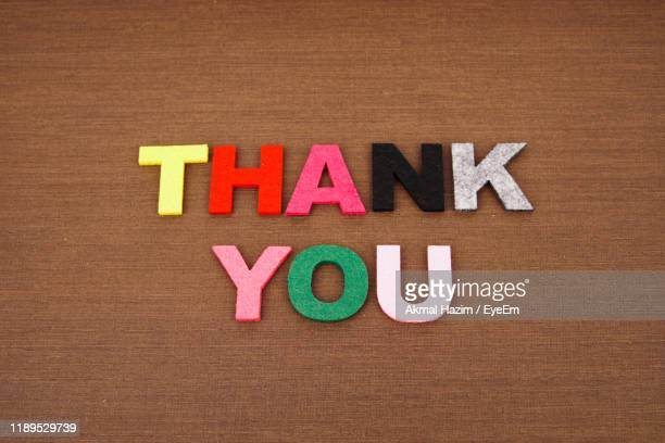 high angle view of thank you text on wooden table - thank you stock pictures, royalty-free photos & images