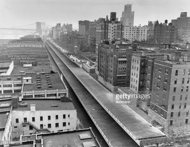 High angle view of the Brooklyn Heights Promenade along the East River, on the day the southern half of the Promenade was opened to the public, in...