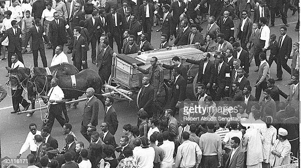 High angle view of the casket of assassinated Civil Rights leader Dr Martin Luther King Jr borne on a muledrawn cart during a massive funeral...