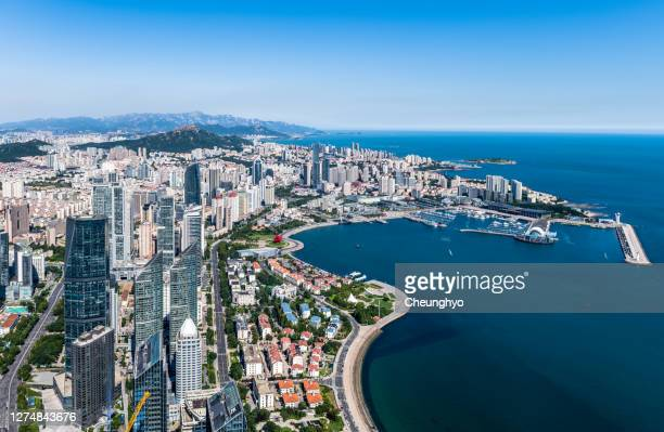high angle view of the cityscape in qingdao, shandong, china - qingdao beach stock pictures, royalty-free photos & images