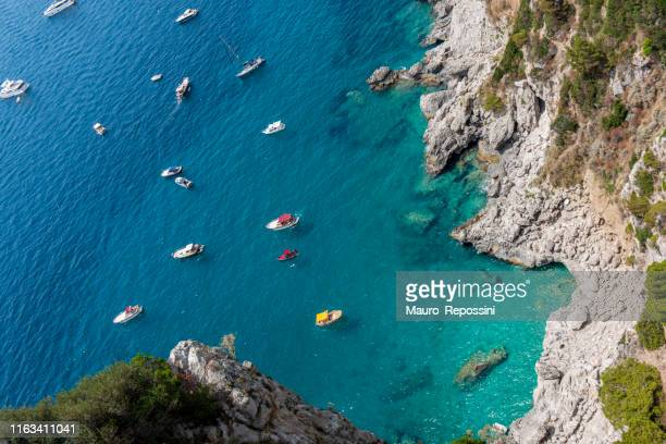 high angle view of the coastline in the island of capri in the tyrrhenian sea in italy. - capri stock pictures, royalty-free photos & images