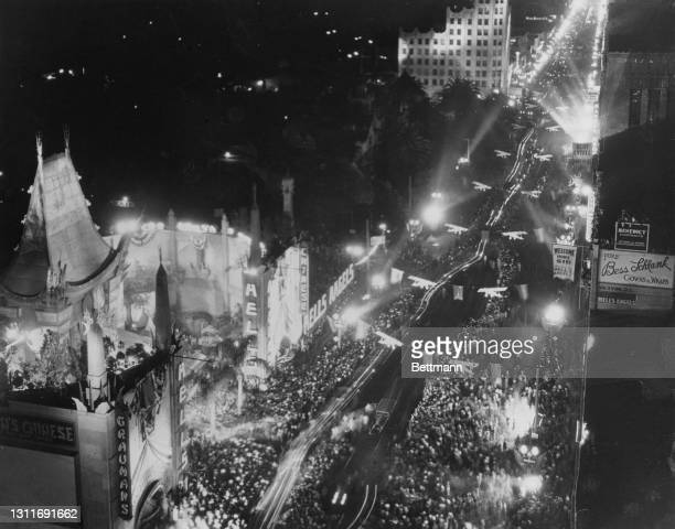 High angle view of the crowds gathered along an illuminated Hollywood Boulevard for the premiere of 'Hell's Angels', held at the Grauman's Chinese...