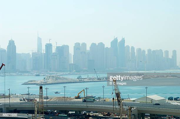 High angle view of the highway, sea and city in the background, Dubai, UAE