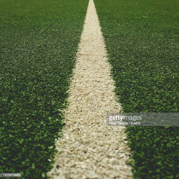 high angle view of the line on a tennis court. - tennis stock pictures, royalty-free photos & images
