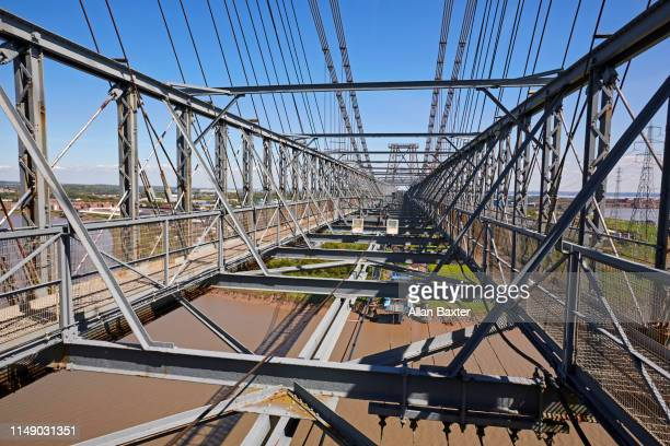 high angle view of the 'newport transporter bridge' spanning the river usk - steel stock pictures, royalty-free photos & images