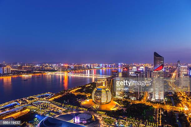 high angle view of the qiantang river and downtown cbd at night,hangzhou,china - hangzhou stock pictures, royalty-free photos & images
