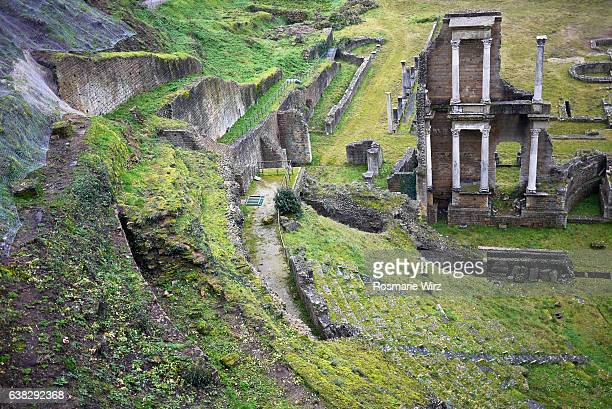 high angle view of the roman theatre in volterra, tuscany. - volterra stock photos and pictures
