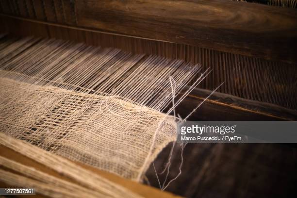 high angle view of thread in loom - wool stock pictures, royalty-free photos & images
