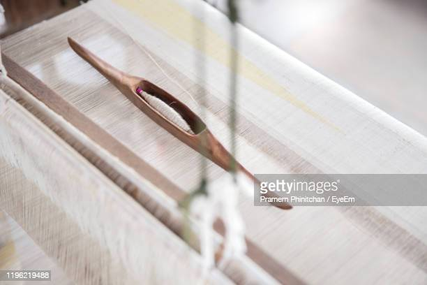 high angle view of thread on loom - loom stock pictures, royalty-free photos & images