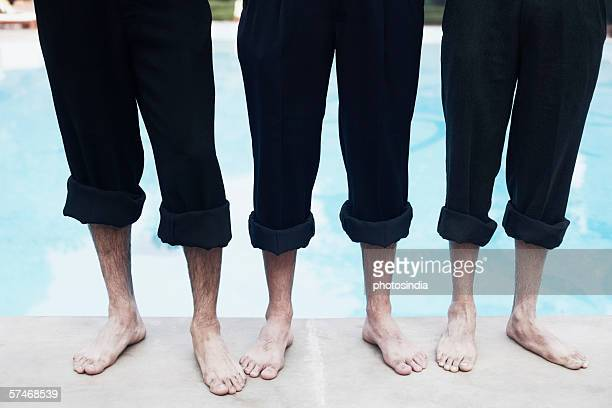 high angle view of three pairs of legs - rolled up trousers stock pictures, royalty-free photos & images