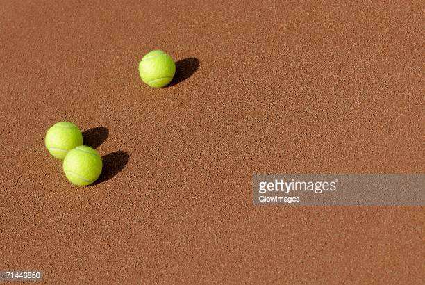 High angle view of three tennis balls