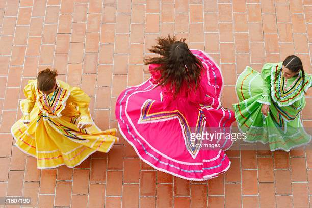 high angle view of three young women dancing - traditional dancing stock pictures, royalty-free photos & images
