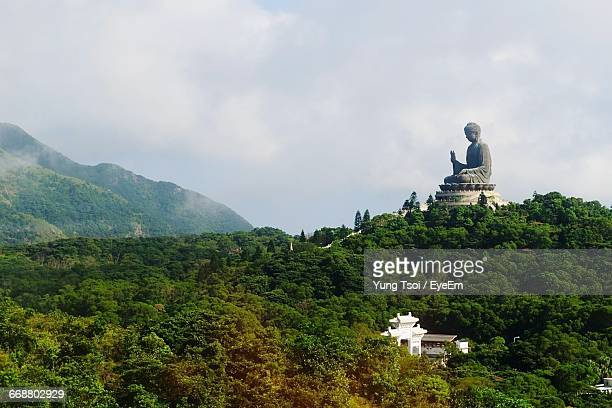 high angle view of tian tan buddha against cloudy sky - lantau stock pictures, royalty-free photos & images