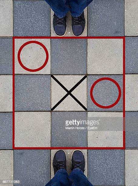 High Angle View Of Tic-Tac-Toe Game On Ground