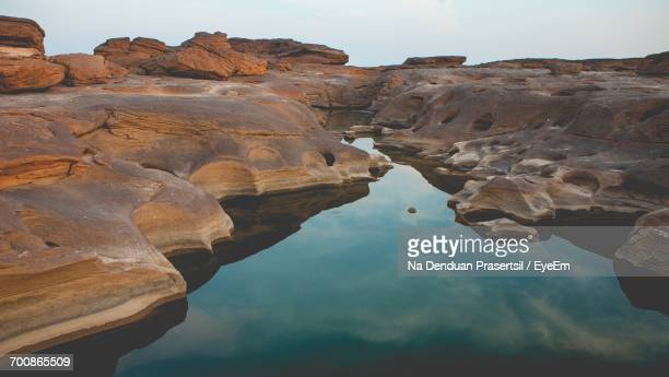 High Angle View Of Tidal Pool On Rock Formation