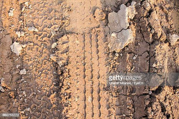 High Angle View Of Tire Track On Mud