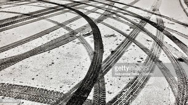 High Angle View Of Tire Tracks On Snow Covered Road