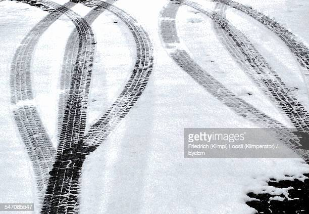 High Angle View Of Tire Tracks On Snow Covered Street
