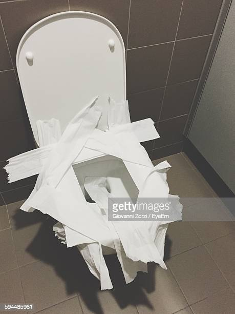 high angle view of tissue paper on toilet bowl in bathroom - toilet bowl stock photos and pictures