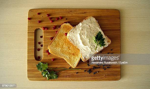 High Angle View Of Toasted Bread And Cheese On Cutting Board