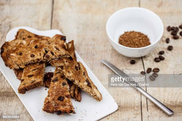 High Angle View Of Toasted Breads In Plate On Table